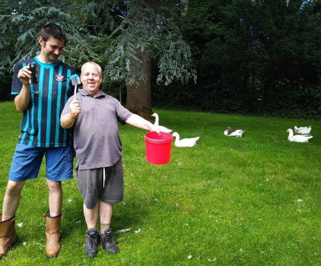 """Here's a post from animal care. Dan and Tim are looking after the geese this afternoon, making sure they have clean water tubs to drink and clean from. Tim said """"we need to do this to make sure they don't get ill"""""""