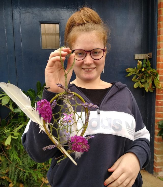 Here's Lucy showing us the dream catcher she has made in nature art this morning. She decided to use lavender because it makes us sleepy. Great work Lucy!